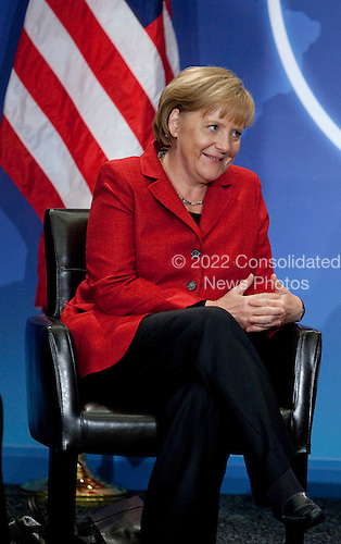 Angela Merkel, Germany's chancellor, speaks to United States President Barack Obama, not pictured, during a bilateral meeting at the Nuclear Security Summit in Washington, D.C., U.S., on Tuesday, April 13, 2010.  Obama urged world leaders today to confront the prospect of nuclear terrorism and take concrete action to head off what he called one of the greatest threats to global security. .Credit: Andrew Harrer / Pool via CNP