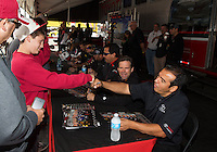 Jul. 27, 2013; Sonoma, CA, USA: NHRA a young fan gets a fist bump from funny car driver Tony Pedregon during qualifying for the Sonoma Nationals at Sonoma Raceway. Mandatory Credit: Mark J. Rebilas-