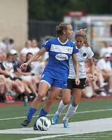 Boston Breakers defender Julie King (8) looks to pass as Portland Thorns FC defender Marian Dougherty (2) closes. In a National Women's Soccer League (NWSL) match, Portland Thorns FC (white/black) defeated Boston Breakers (blue), 2-1, at Dilboy Stadium on July 21, 2013.
