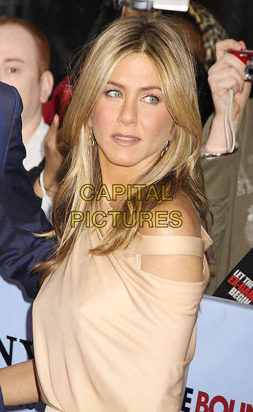 JENNIFER ANISTON .'The Bounty Hunter' New York Premiere held at the Ziegfeld Theatre, New York , NY, USA, 16th March 2010..arrivals portrait headshot  beige off the  shoulder  side cut out .CAP/ADM/AC.©Alex Cole/AdMedia/Capital Pictures.