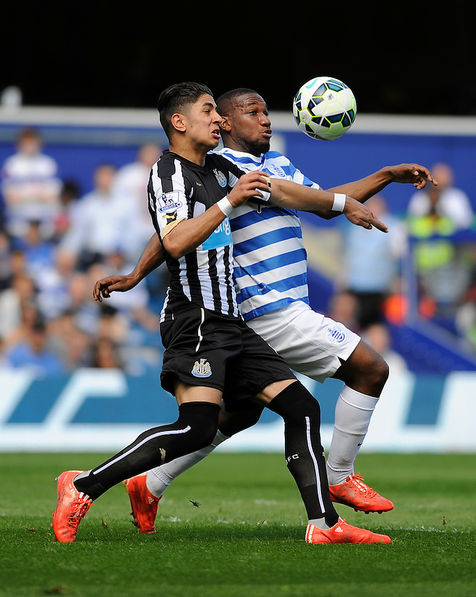 Queens Park Rangers' David Hoilett vies for possession with Newcastle United's Ayoze Perez<br /> <br /> Photographer Ashley Western/CameraSport<br /> <br /> Football - Barclays Premiership - Queens Park Rangers v Newcastle United - Saturday 16th May 2015 - Loftus Road - London<br /> <br /> &copy; CameraSport - 43 Linden Ave. Countesthorpe. Leicester. England. LE8 5PG - Tel: +44 (0) 116 277 4147 - admin@camerasport.com - www.camerasport.com