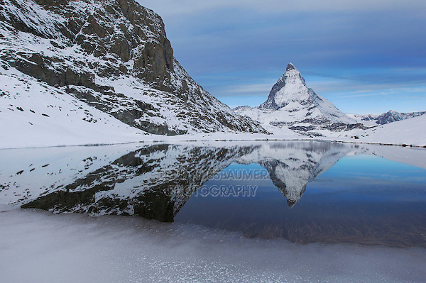 Matterhorn in winter with reflection in the Riffelsee, Zermatt, Valais, Switzerland
