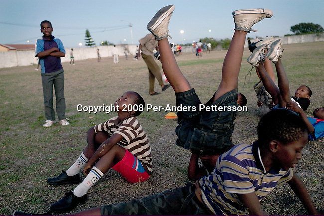CAPE TOWN, SOUTH AFRICA - FEBRUARY 19: Members of a youth soccer team practice on February 19, 2008 in Nyanga, a poor township outside Cape Town, South Africa. Many of these children dream of being professional players in the future. The 2010 World Cup Soccer tournament will be held in South Africa, the first time on the African continent. (Photo by: Per-Anders Pettersson Reportage by Getty Images).