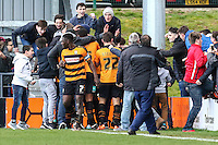John Akinde of Barnet celebrates scoring his team's second goal against Luton Town to make it 2-1 with tam mates and fans during the Sky Bet League 2 match between Barnet and Luton Town at The Hive, London, England on 28 March 2016. Photo by David Horn.