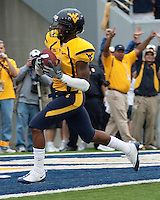 WVU wide receiver Tavon Austin scores. The WVU Mountaineers defeated the East Carolina Pirates 35-20 at Mountaineer Field at Milan Puskar Stadium, Morgantown, West Virginia on September 12, 2009.