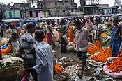Vendors wait for their customers at the Mullik Ghat Flower market in Howrah, Kolkata, West Bengal  on Friday, May 26, 2017. Photographer: Sanjit Das