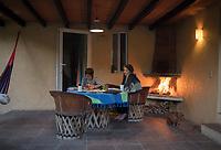 Annuska and Obie by the fire. Cuatepetitla house with Obie, San Jose de los Laureles, Morelos, Mexico