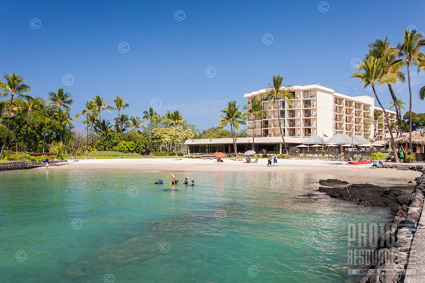 Tourists enjoy the water in Kamakahonu Bay, which fronts King Kamehameha's Kona Beach Hotel in Kailua-Kona, Big Island.