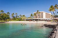 Tourists enjoy the water in Kamakahonu Bay, which fronts King Kamehameha's Kona Beach Hotel in Kailua-Kona, Big Island.