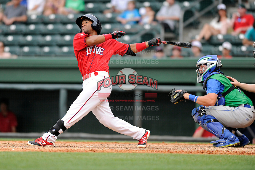 Second baseman Wendell Rijo (11) of the Greenville Drive bats in a game against the Lexington Legends on Sunday, April 27, 2014, at Fluor Field at the West End in Greenville, South Carolina. Rijo is the No. 18 prospect of the Boston Red Sox, according to Baseball America. The Lexington catcher is Chad Johnson. Greenville won, 21-6. (Tom Priddy/Four Seam Images)