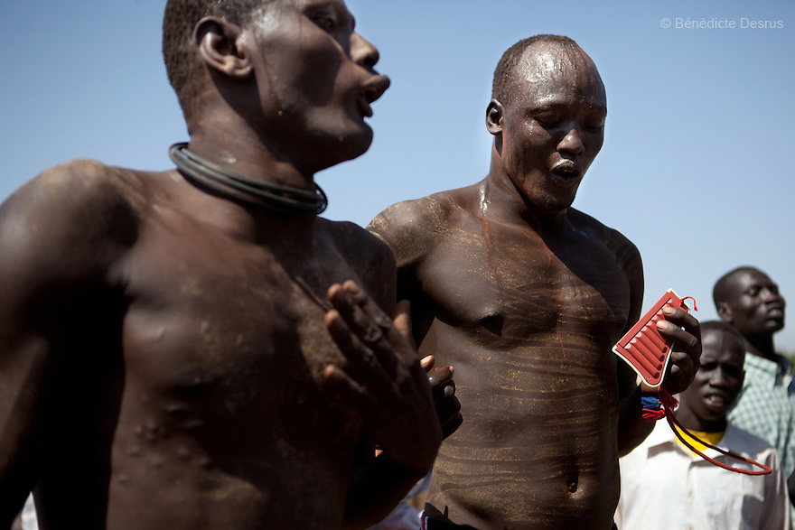 18 december 2010 - Juba, Southern Sudan - Wrestlers of the Mundari tribe from Central Equatoria State before the final of South Sudan's first commercial wrestling league between their tribe and the Dinka wrestlers from Bor, Jonglei State at Juba Stadium. The matches attracted large numbers of spectators who sang, played drums and danced in support of their favorite wrestlers. The match organizers hoped that the traditional sport would bring together South Sudan's many different tribes. Photo credit: Benedicte Desrus