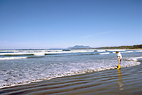 Woman wading in the Pacific Ocean at Low Tide at Long Beach, in Pacific Rim National Park Reserve, on the West Coast of Vancouver Island, British Columbia, Canada (Model Released)