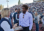 October 6, 2012:   Cary Groth, Nevada Director of Athletics talks with Nate Burleson, Detroit Lions receiver on the sidelines of the Nevada Wolf Pack vs Wyoming Cowboys football game played at Mackay Stadium on Saturday afternoon in Reno, Nevada.  Nate Burleson received his Nevada Hall of Fame plaque.