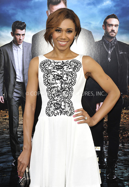 WWW.ACEPIXS.COM....March 26 2013, LA....Toks Olagundoye arriving at the 'Rogue' Los Angeles premiere at ArcLight Hollywood on March 26, 2013 in Hollywood, California.....By Line: Peter West/ACE Pictures......ACE Pictures, Inc...tel: 646 769 0430..Email: info@acepixs.com..www.acepixs.com