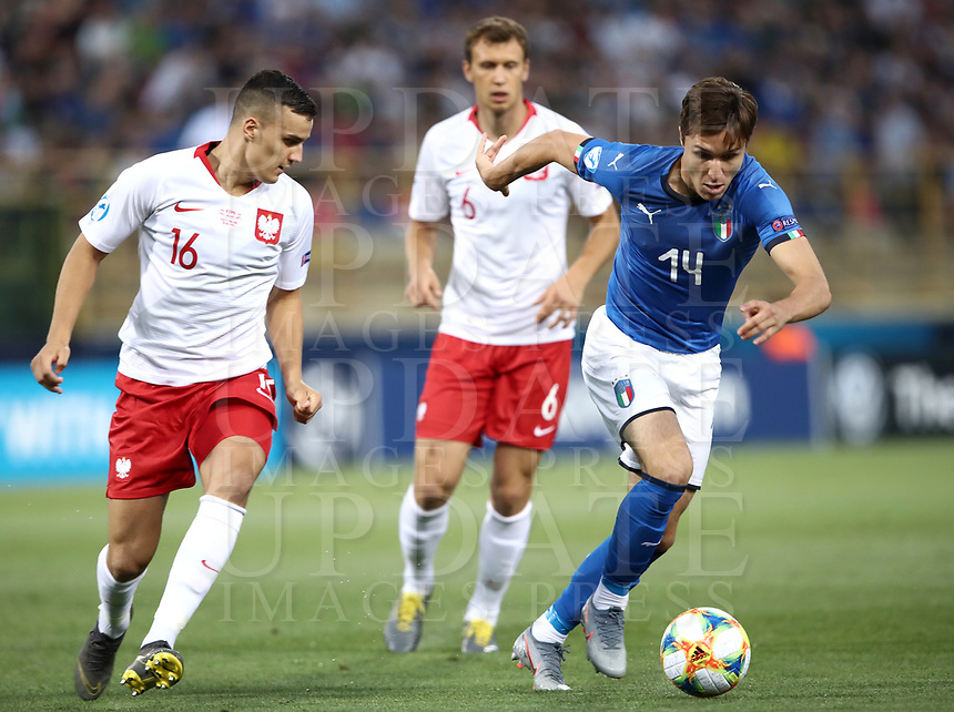 Football: Uefa under 21 Championship 2019, Italy -Poland, Renato Dall'Ara stadium Bologna Italy on June19, 2019.<br /> Italy's Federico Chiesa (r) in action with Poland's Patryk Dziczek (l) and Krystian Bielik (c) during the Uefa under 21 Championship 2019 football match between Italy and Poland at Renato Dall'Ara stadium in Bologna, Italy on June19, 2019.<br /> UPDATE IMAGES PRESS/Isabella Bonotto