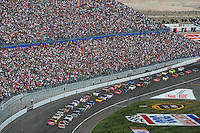 Mar 2, 2008; Las Vegas, NV, USA; NASCAR Sprint Cup Series drivers Kyle Busch (18) and Carl Edwards 999) lead the field to the green during the UAW Dodge 400 at Las Vegas Motor Speedway. Mandatory Credit: Mark J. Rebilas-US PRESSWIRE