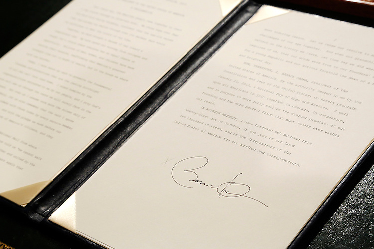 A proclamation to commeorate the inauguration, entitled a National Day of Hope and Resolve, bears U.S. President Barack Obama's signature directly after swearing-in ceremonies in the U.S Capitol in Washington, January 21, 2013. REUTERS/Jonathan Ernst   (UNITED STATES)