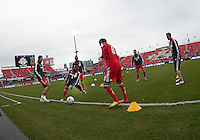 14 April 2012: Chivas USA players kick the ball around during the warm-up in a game between Chivas USA and Toronto FC at BMO Field in Toronto..Chivas USA won 1-0..