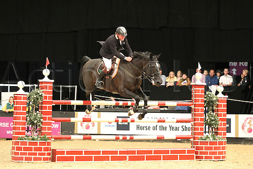 08.10.2010 The Horse of the Year Show from the NEC in Birmingham. Riding in the Dick Turpin Stakes. Tim Stockdale (GBR) riding Victoria