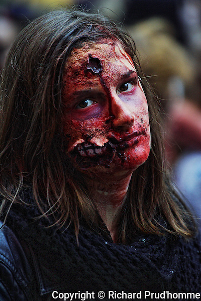 A disfigured female participating in the Montreal zombie walk