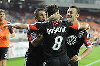 D.C. United forward Hamdi Salihi (9) celebrates his score in the 60th minute of the game with teammates Branko Boskovic and Danny Cruz. D.C. United defeated the Colorado Rapids 2-0 at RFK Stadium, Wednesday May 16, 2012.