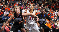 Duke guard Tricia Liston (32) and Duke guard Alexis Jones (2) looks for the rebound with Virginia guard Ataira Franklin (23) during an NCAA college basketball game in Charlottesville, Va. Duke defeated Virginia 62-41...