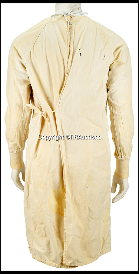 BNPS.co.uk (01202 558833)<br /> Pic :   RRAuctions/BNPS<br /> <br /> A hospital gown worn by legendary rocker Kurt Cobain during an iconic Reading Festival set has emerged for sale for £40,000. ($50,000)<br /> <br /> The Nirvana frontman chose the unusual attire to poke fun at media speculation about his wellbeing ahead of their performance on August 30, 1992.<br /> <br /> He was pushed on stage in a wheelchair and pretended to collapse before jumping up and delivering a blistering set considered to be one of the band's finest.<br /> <br /> Two years later Cobain committed suicide and his on-off partner Courtney Love gave the gown to a shocked fan who had attended a vigil for him.<br /> <br /> The fan kept hold of it for 25 years before deciding now to consign it for sale with US auction house RR Auctions.