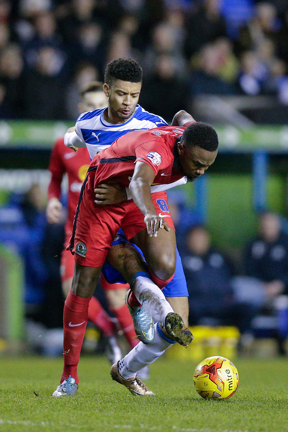 Blackburn Rovers' Bengadli-Fode Koita holds off the challenge from Reading's Michael Hector<br /> <br /> Photographer Craig Mercer/CameraSport<br /> <br /> Football - The Football League Sky Bet Championship - Reading v Blackburn Rovers - Sunday 20th December 2015 - Madejski stadium - Reading<br /> <br /> &copy; CameraSport - 43 Linden Ave. Countesthorpe. Leicester. England. LE8 5PG - Tel: +44 (0) 116 277 4147 - admin@camerasport.com - www.camerasport.com