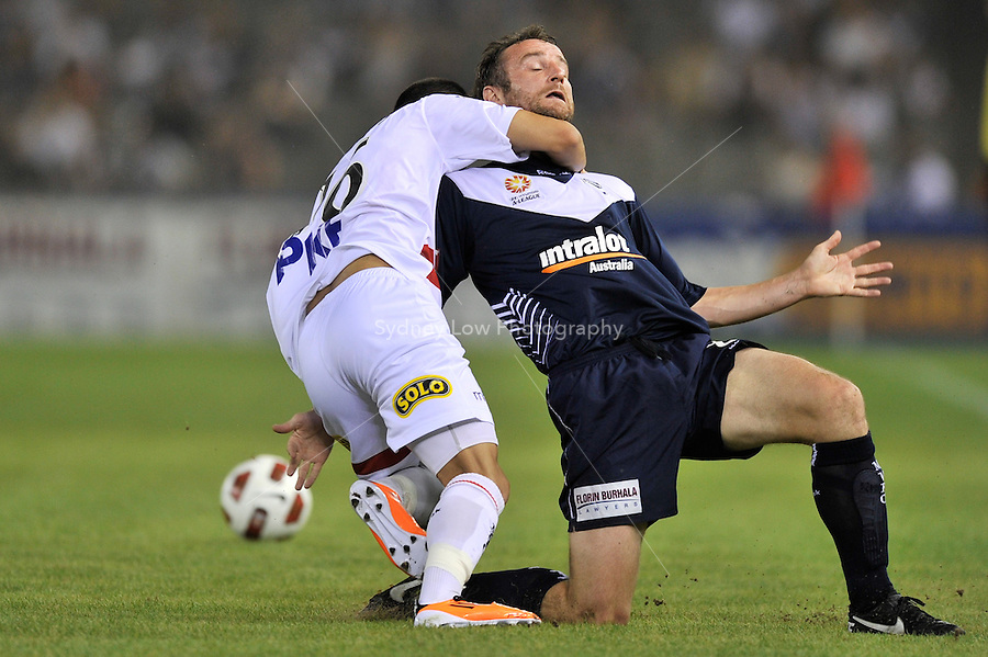 MELBOURNE, AUSTRALIA - JANUARY 22: Grant Brebner of the Victory and Aziz Behich of the Heart contest for the ball in round 24 of the  A-League match between the Melbourne Victory and the Melbourne Heart at Etihad Stadium on January 22, 2011 in Melbourne, Australia. (Photo Sydney Low / AsteriskImages.com)