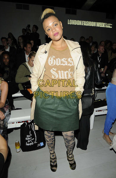 Gemma Cairney.The Fashion Fringe s/s 2013 catwalk show, London Fashion Week final Day 5, Courtyard Show Space, Somerset House, The Strand, London, England..September 18th, 2012.LFW full length  gossip sucks brown top green skirt hands in pockets leather dyed blonde hair beige mac  leopard print tights.CAP/CAN.©Can Nguyen/Capital Pictures.