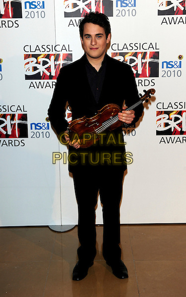 JACK LIEBECK .Attends the 2010 Classical Brit Awards .nomination launch.held at The Mayfair Hotel  in London, England, UK, 12th April 2010..full length suit  black grey gray  holding violin.CAP/CJ.©Chris Joseph/Capital Pictures.