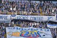 BOGOTA - COLOMBIA -13 -02-2016: Hinchas de Millonarios animan a su equipo durante el encuentro entre Millonarios y Deportivo Pasto por la fecha 3 de la Liga Águila I 2016 jugado en el estadio Nemesio Camacho El Campín de la ciudad de Bogotá./ Fans of Millonarios cheer for their team during a match between Millonarios and Deportivo Pasto for the date 3 of the Aguila League I 2016 played at Nemesio Camacho El Campin stadium in Bogota city. Photo: VizzorImage / Gabriel Aponte / Staff.