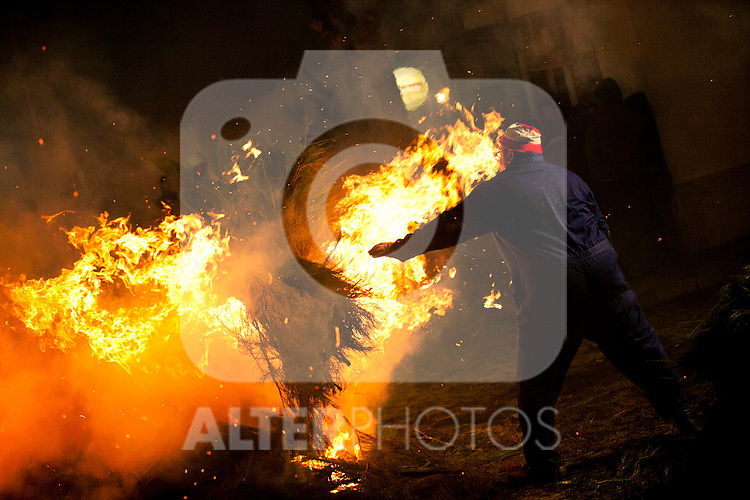 SAN BARTOLOME DE PINARES, SPAIN - JANUARY 16: Huge bonfires are prepared in the streets of the village on January 16, 2013 in San Bartolome de Pinares, Spain. In honor of San Anton, the patron saint of animals, horses are riden through the bonfires on the night before the official day of honoring animals in Spain. Victor J. Blanco / Alterphotos