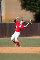 Belmont Abbey Crusaders shortstop Colin Rosenbaum (10) can't hold on to this pop fly during the game against the Shippensburg Raiders at Abbey Yard on February 8, 2015 in Belmont, North Carolina.  The Raiders defeated the Crusaders 14-0.  (Brian Westerholt/Four Seam Images)