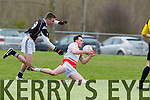 Sean O Gairbhia  Corcha Dhuibhne is tripped up by Sean Ryan Clonakilty CC during the Corn Uí Mhuirí Munster semi final in Knocknagree on Saturday
