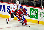 17 October 2009: Ottawa Senators defenseman Anton Volchenkov skates to defend against Montreal Canadiens left wing forward Mike Cammalleri at the Bell Centre in Montreal, Quebec, Canada. The Senators defeated the Canadiens 3-1. Mandatory Credit: Ed Wolfstein Photo
