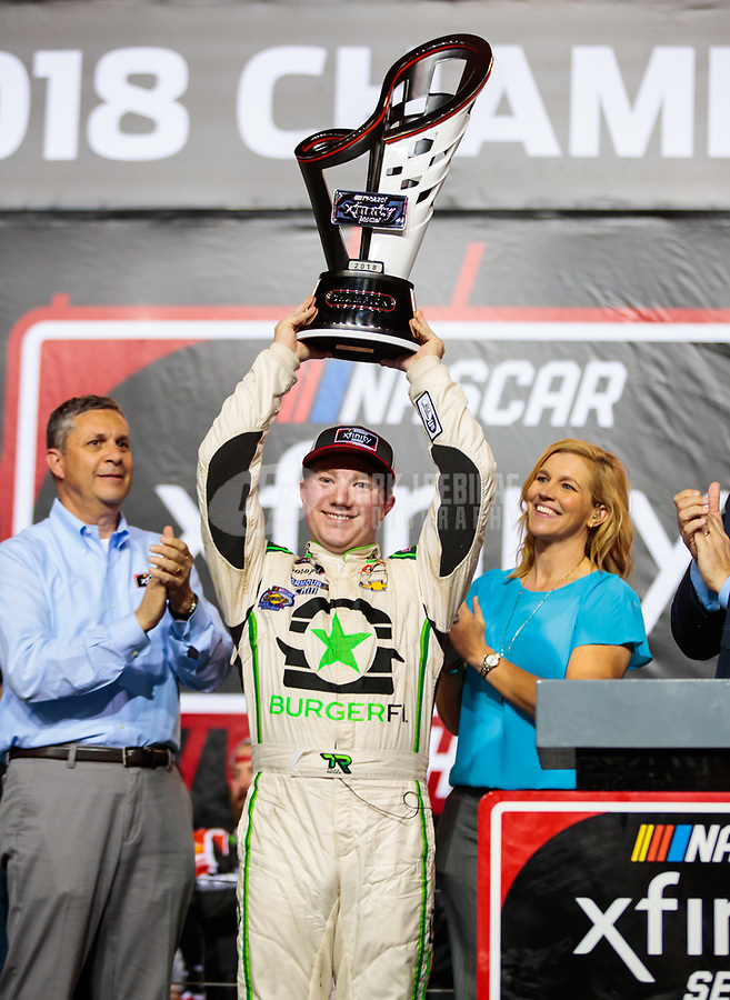 Nov 17, 2018; Homestead, FL, USA; NASCAR Xfinity Series driver Tyler Reddick celebrates after winning the 2018 championship and the Ford EcoBoost 300 at Homestead-Miami Speedway. Mandatory Credit: Mark J. Rebilas-USA TODAY Sports