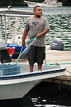 Palau, Micronesia -- Cleaning the boat after a day out on the ocean.