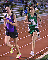 Eureka's Hannah Long-left, and Ste. Genevieve's Taylor Werner race under the lights at the Festus Tiger Town Track and Field Invitational, Tuesday, April 2, 2013, Festus, Mo. The pair who finished 10th-Long, and 13th-Werner at the 2012 FootLocker Cross Country Championships in December in San Diego, posted two of the top 10 times in the 3200 meters among high school girls at Festus, with Werner beating Long to the finish, 10:25.88 to 10:27.49.