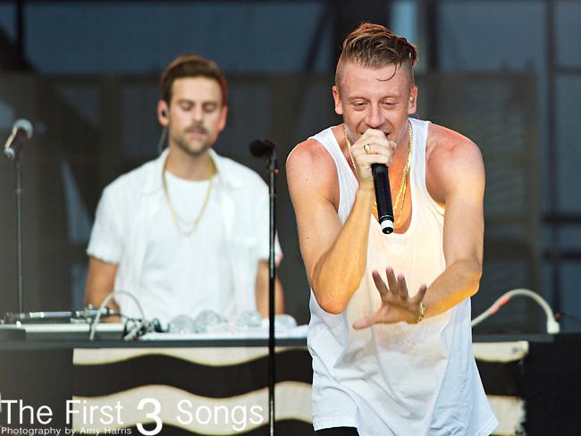 Macklemore (born Ben Haggerty) of Macklemore & Ryan Lewis performs during the 2013 Budweiser Made in America Festival in Philadelphia, Pennsylvania.