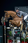 Philipp Weishaupt of Germany rides Carinou in action during the Longines Grand Prix as part of the Longines Hong Kong Masters on 15 February 2015, at the Asia World Expo, outskirts Hong Kong, China. Photo by Victor Fraile / Power Sport Images