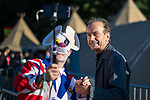 © Joel Goodman - 07973 332324. 05/08/2017 . Macclesfield , UK . Hugh Cornwell of the Stranglers at the Rewind Festival , posing with a fan dressed as Danger Mouse , celebrating 1980s music and culture , at Capesthorne Hall in Siddington . Photo credit : Joel Goodman