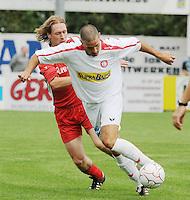 FC Gullegem - KSV Moorsele..Thorsten Clarysse met de bal aan de voet tegenover Piet Vansteenkiste (rechts)..foto VDB / BART VANDENBROUCKE
