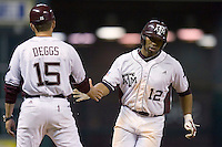 Kyle Colligan #12 of the Texas A&M Aggies is congratulated by Texas A&M Aggies coach Matt Deggs #15 as he rounds third base following his home run versus the Houston Cougars in the 2009 Houston College Classic at Minute Maid Park March 1, 2009 in Houston, TX.  The Aggies defeated the Cougars 5-3. (Photo by Brian Westerholt / Four Seam Images)