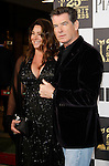 US actor Pierce Brosnan arrives with his wife at the 25th Independent Spirit Awards held at the Nokia Theater in Los Angeles on March 5, 2010. The Independent Spirit Awards is a celebration honoring films made by filmmakers who embody independence and originality..Photo by Nina Prommer/Milestone Photo