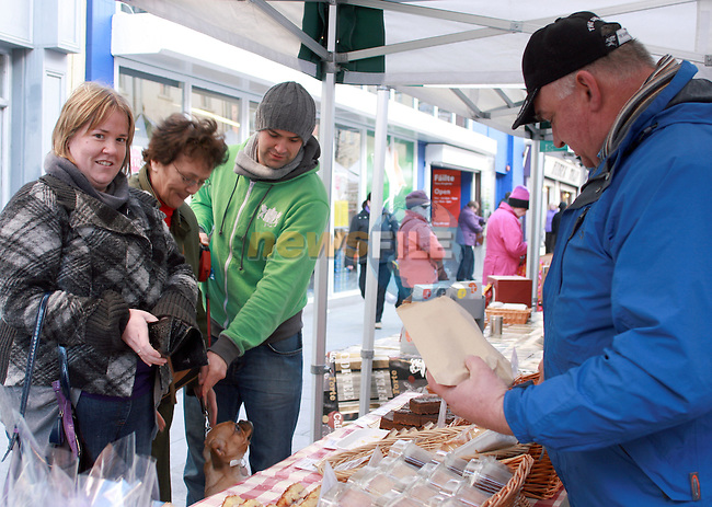 Fiona Staunton, Sarah Kelly and John Kelly with Billy the dog and Ken from Noirins Bakery at the stalls on West Street...Photo NEWSFILE/Jenny Matthews.(Photo credit should read Jenny Matthews/NEWSFILE)....This Picture has been sent you under the condtions enclosed by:.Newsfile Ltd..The Studio,.Millmount Abbey,.Drogheda,.Co Meath..Ireland..Tel: +353(0)41-9871240.Fax: +353(0)41-9871260.GSM: +353(0)86-2500958.email: pictures@newsfile.ie.www.newsfile.ie.FTP: 193.120.102.198.