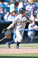 Charleston RiverDogs catcher Collin Slaybaugh (16) swings at a pitch during a game against the Asheville Tourists on June 13, 2015 in Asheville, North Carolina. The Tourists defeated the RiverDogs 10-6. (Tony Farlow/Four Seam Images)