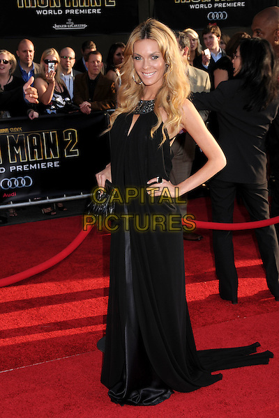 "JASMINE DUNSTIN .""Iron Man 2"" World Premiere held at the El Capitan Theatre, Hollywood, California, USA, 26th April 2010..arrivals full length feather clutch bag black long maxi dress hands on hips train .CAP/ADM/BP.©Byron Purvis/AdMedia/Capital Pictures."
