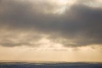 Sunset on the sea ice along the coast of the Norton Sound, near Nome, Alaska.