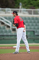 Kannapolis Intimidators starting pitcher Spencer Adams (12) looks to his catcher for the sign against the Hickory Crawdads at CMC-Northeast Stadium on April 17, 2015 in Kannapolis, North Carolina.  The Crawdads defeated the Intimidators 9-5 in game one of a double-header.  (Brian Westerholt/Four Seam Images)